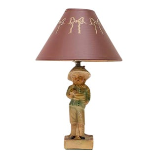 French Boy Chalkware Figural Small Lamp For Sale