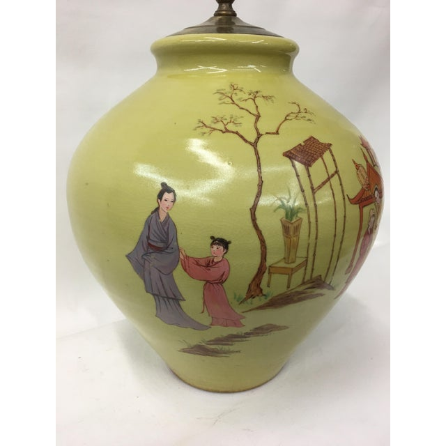 Classic chinoiserie inspired scene showing figures playing in a courtyard. This lighthearted scene is perfect for bringing...