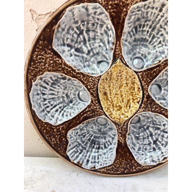 19th Century French Majolica Oyster Plate unsigned , with a lemon on the center.