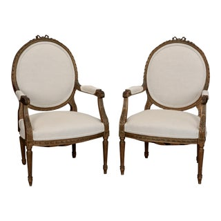 Pair of Louis XVI Oval Back Gilded Frame Fauteuils For Sale