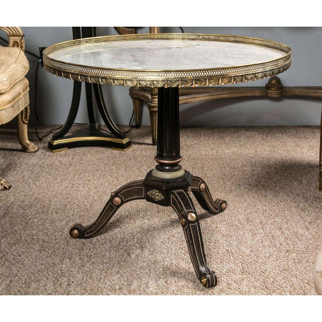 A very fine and rare Russian Neoclassical style Centre Table by Jansen. This table has ebonized woods and is finely casted...
