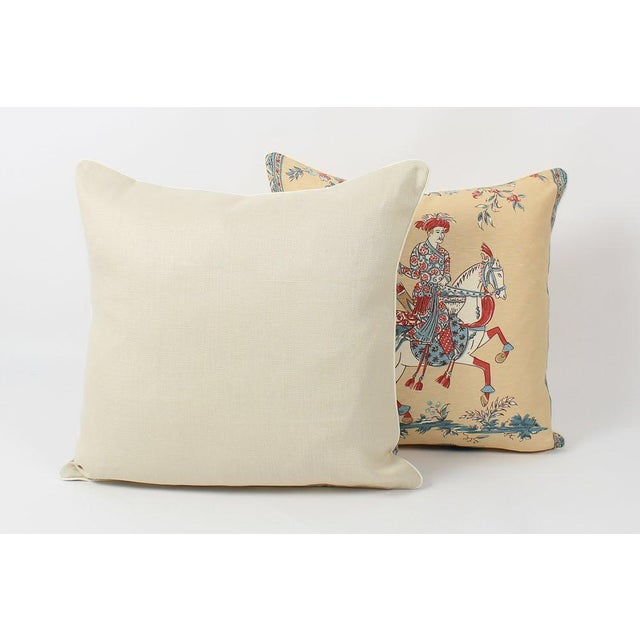 Pair of custom-tailored pillows in Chinoiserie printed fabric depicting a beautiful and colorful figural design with bird...