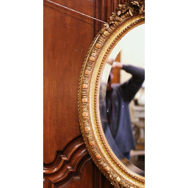 19th Century French Louis XVI Carved Giltwood Oval Wall Mirror With Torch Motif For Sale In Dallas - Image 6 of 12