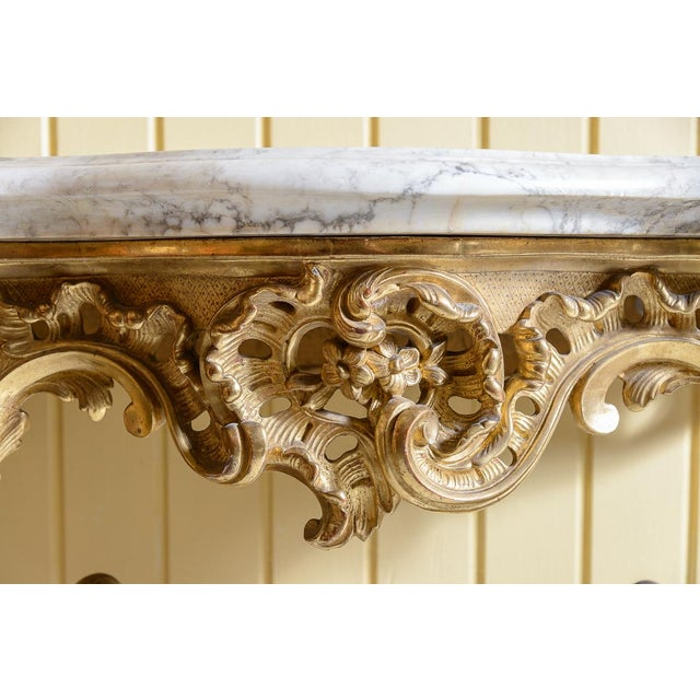 Beautiful, 19th century, French gilt console table with a white marble top.