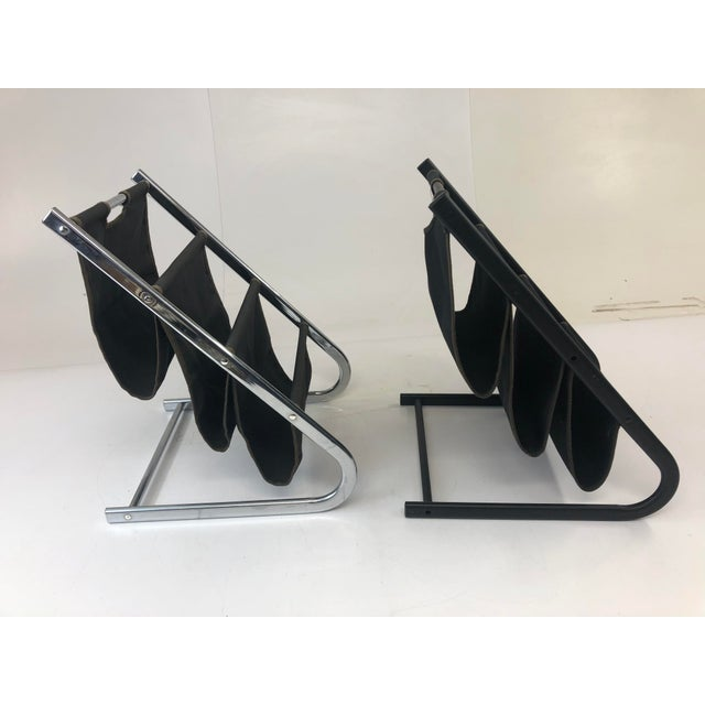 Vintage Magazine Racks. Matching pair. Metal construction with black canvas pockets. Light, light marks. No chips to...