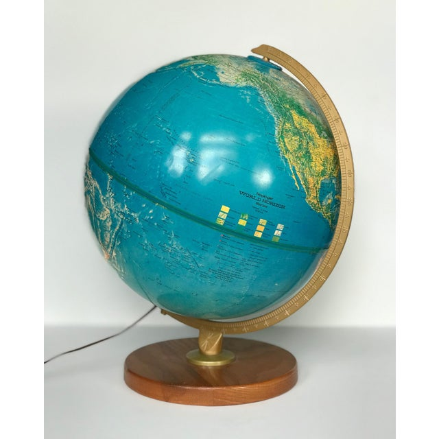Cool vintage globe light. Working world globe on hardwood base. Globe spins on axis AND lights up! Light switch on cord....