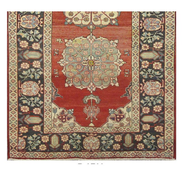 This beautiful rug is hand made, made in Iran. It features a pattern in a vibrant combination of red, navy,blue,grey,...