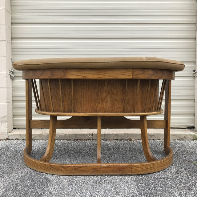 1970s Stunning Solid Oak Bar made by Howard Furniture Company. Elegantly swooping curved lines make this bar a showpiece!...