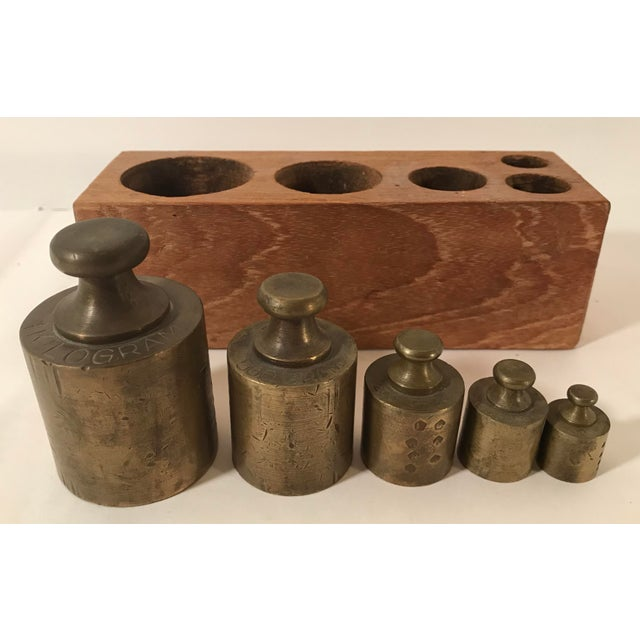 Great set of brass Apothecary weights in a wooden box. There are 5 pieces plus the box - each are marked - 1 KG, 500G,...