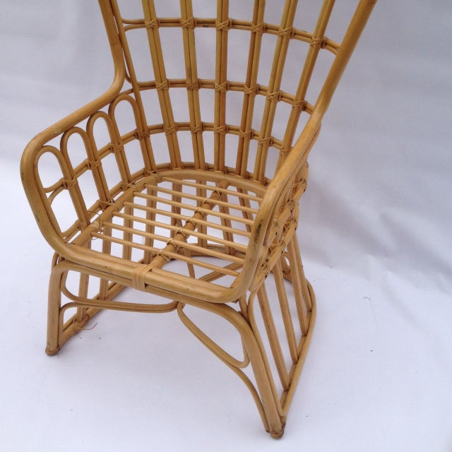 A Franco Albini inspired rattan chair with a peacock fan back. This chair is perfect for your living room, porch or garden...