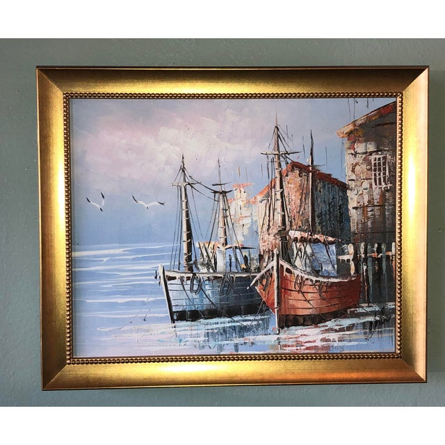 A small vintage signed French boats in harbor painting in gilt frame.