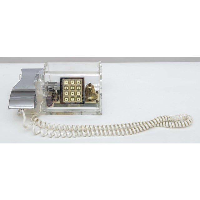 1970's Ultra chic clear Lucite phone with chrome finish handset by TeleConcepts. Push button phone. Brass bell inside,...
