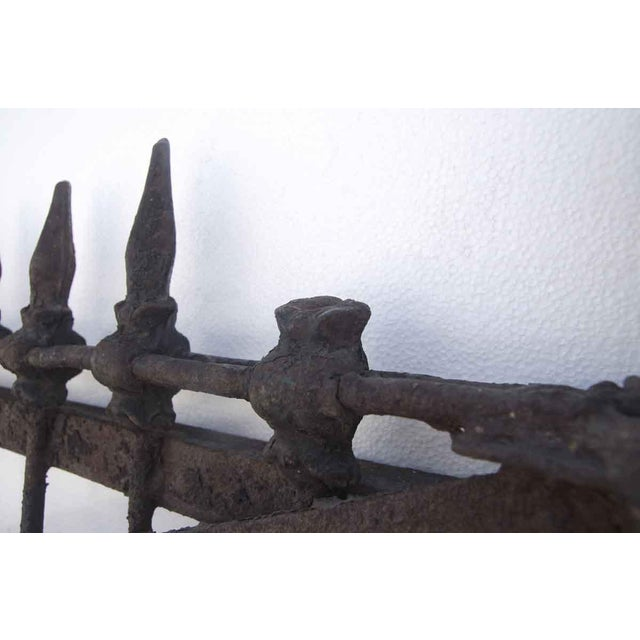 Forged wrought iron driveway gates with a black and rusted finish from the 1800s. Two finials are missing. Priced as a...