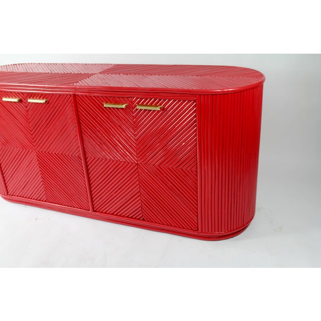 Selling this 1950s bamboo consul sideboard in coral lacquer newly restored brand new European hinges fresh finish...