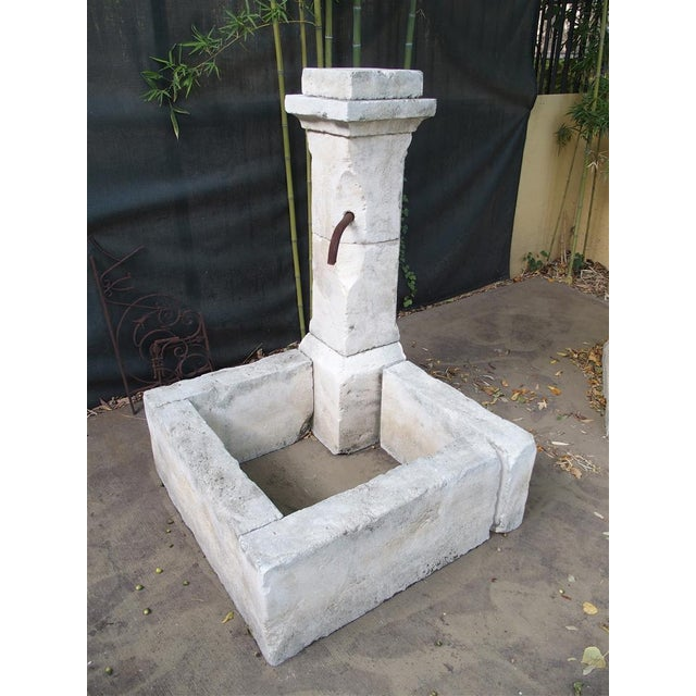 This is a hand carved fountain from France. It is made in Estaillade limestone, with a soft natural color patina added to...