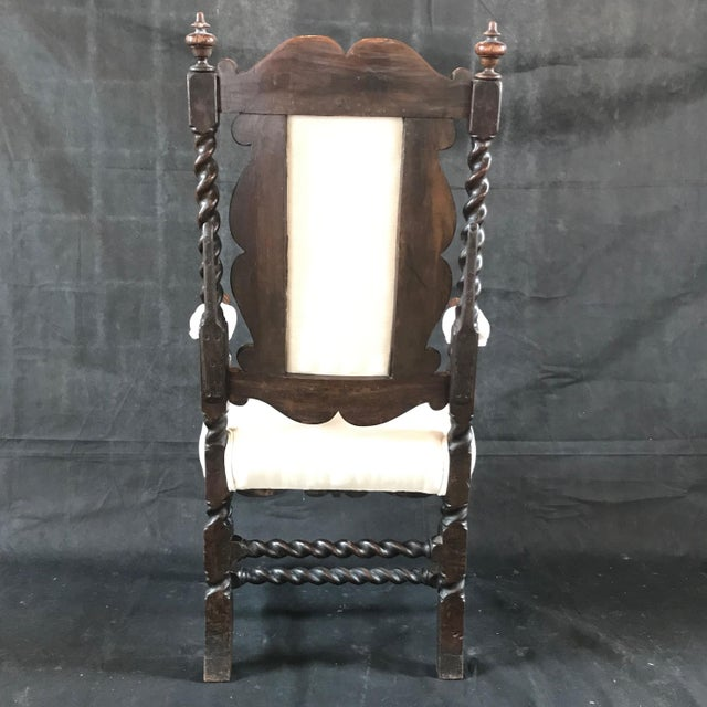 British early antique magnificently carved oak arm chair having amazing barley twist details, curlicues, scroll arms, and...