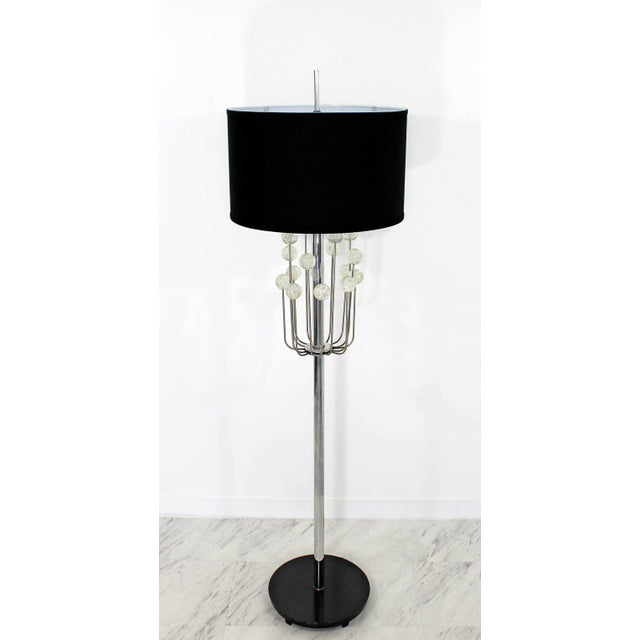 For your consideration is a stunning, chrome floor lamp, with a unique Lucite ball design, with the original finial, circa...