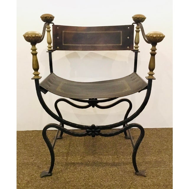 Timeless Antique Iron and Leather Campaign Chair, antique brass detail, tooled leather, textured iron frame, Circa early...