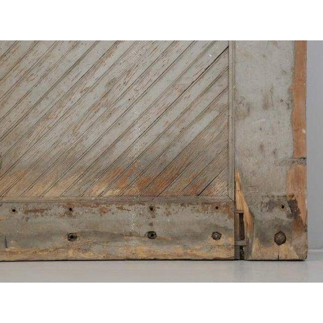 Antique American pair of barn or garage doors made from Douglas-fir. We believe that this pair of American barn or garage...