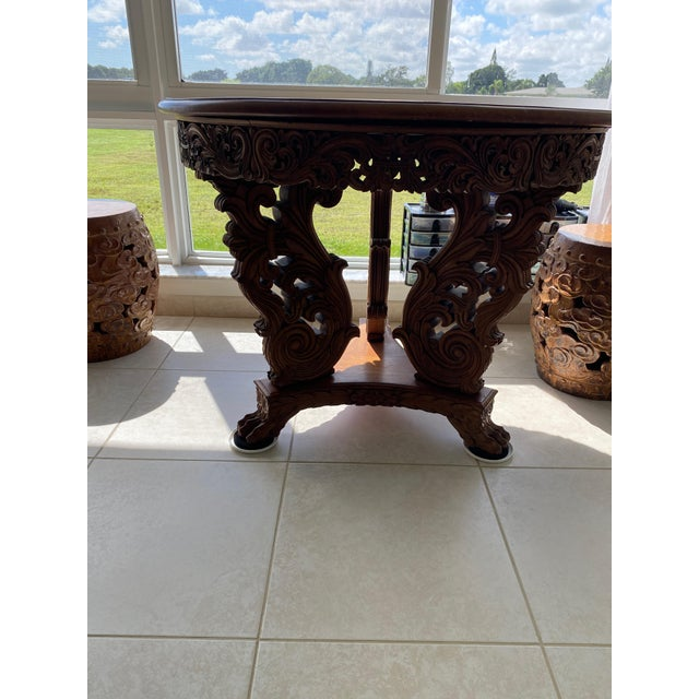 Incredible Burmese antique table, suitable for dining or a dramatic center table. Solid wood, the top attaches solidly to...