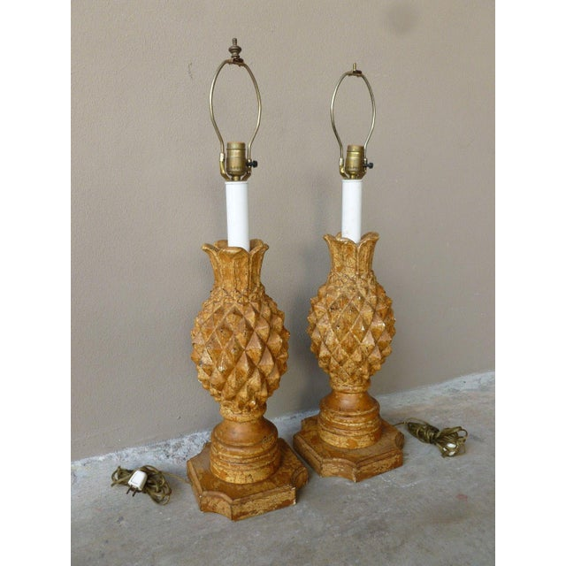 Pair of Mid Century haute design Italian carved wood pineapple lamps with a crackle finish sold as found in original...