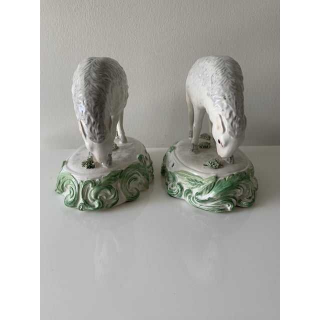 Adorable pair of porcelain sheep. Hand made and hand-painted in Italy. Signed by Chelsea House, Port Royal.