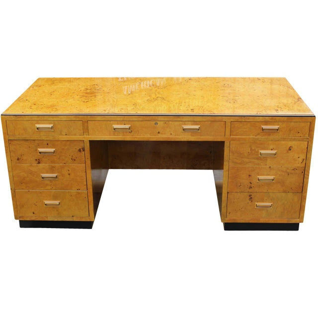 Beautiful burl wood executive desk with glass top by Henredon, series II. Exceptional solid construction, desk is veneered...
