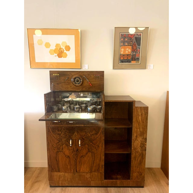 1950s drop door liquor cabinet with shelving, mirror, skeleton key. Also comes with 6 decorative olive picks and a vintage...