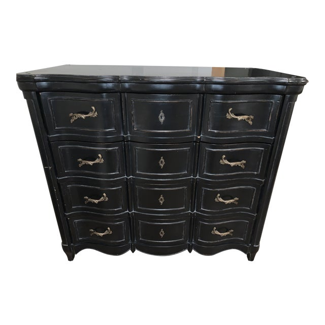 This is a beautiful 4-drawer French serpentine style hardwood dresser is an exclusive Williams-Sonoma design. The dresser...