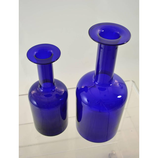 """Wonderful deep cobalt glass in class Holmegaard vases. Two sizes: The larger: 15"""" height, 5.75"""" diameter and the smaller:..."""
