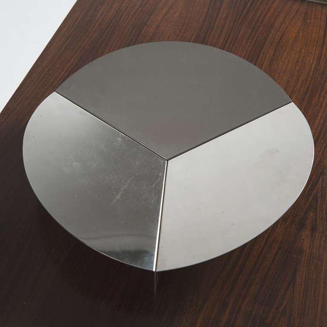 Rare Steel centerpiece by Gianfranco Grignani for Luci. This company, specialized in lighting design, made limited...