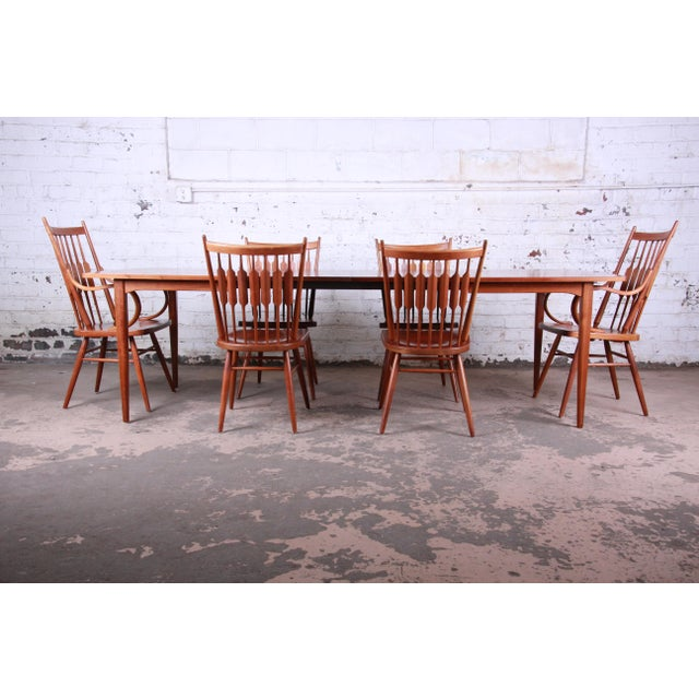 A gorgeous mid-century modern walnut extension dining table and chairs designed by Kipp Stewart for his Declaration line...