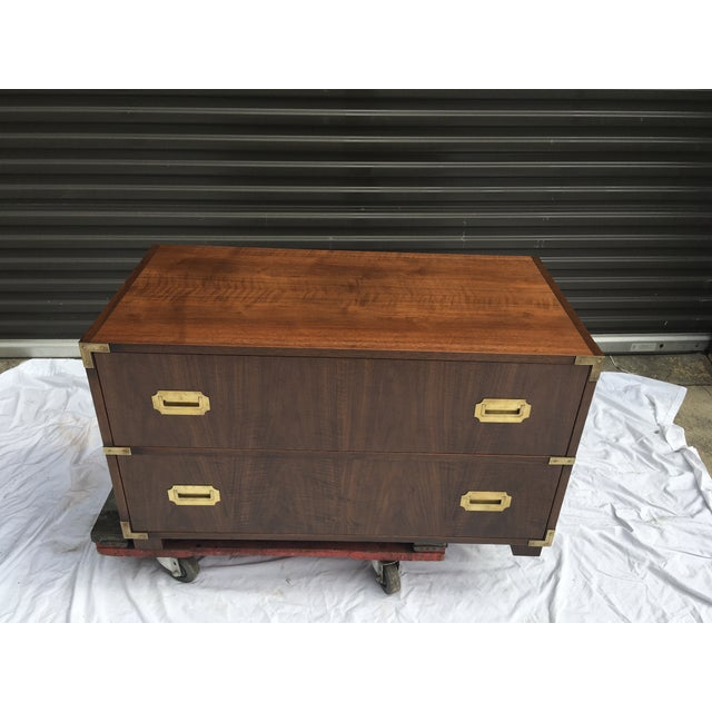 """Baker Furniture, low, campaign style chest, in walnut and brass. This piece is typical of """"1 stack"""" of 2 drawers. Finished..."""