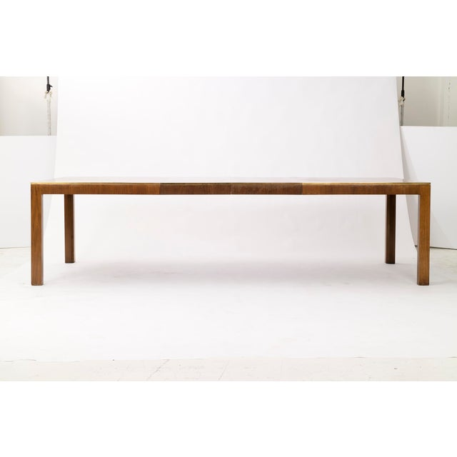 Burl Wood dining table with brass edge accents. Included two leave at 20 in. each. Explanded the table measures 112 in....