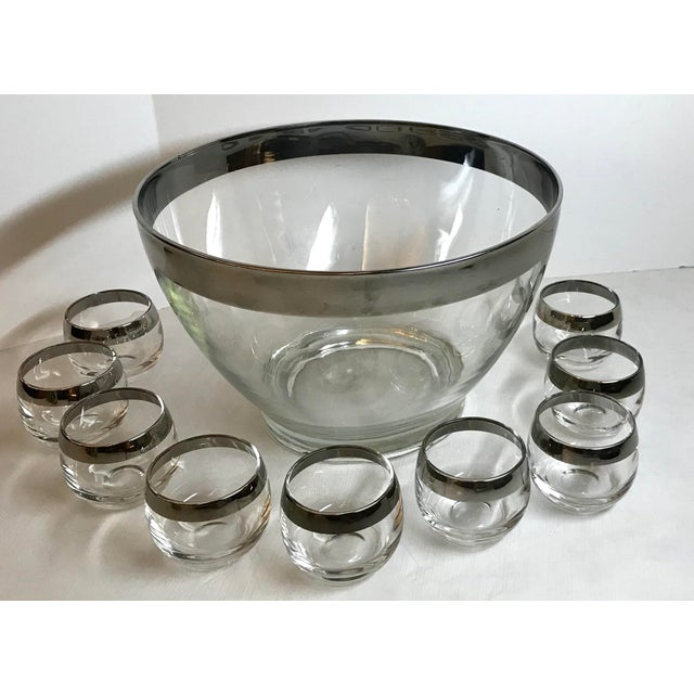 "Beautiful Dorothy Thorpe Silver band Set includes punch bowl and 9 roly poly matching cups. Cups measure 2.25"" x 2.25"" x..."