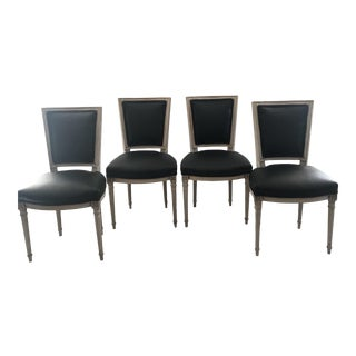 Carved and Painted Louis XVI Chairs With Black Leather Seats - a Set For Sale