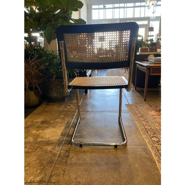 Set of 4 Black Cane Chrome Frame Armless Chairs. Pairs perfectly with any modern table to add an edge!