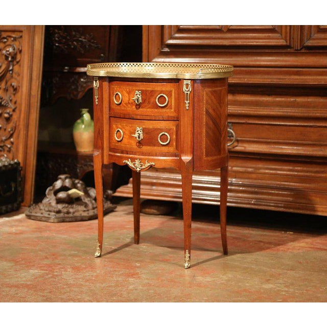 This elegant, kidney-shaped fruitwood commode is a versatile side table for any room. Crafted in Paris, France, circa...