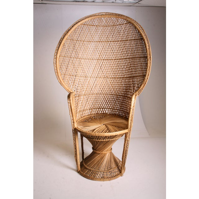 Vintage Wicker PEACOCK Chair. Piece is very clean. Chair can hold a lot of weight. Single piece construction. High back....