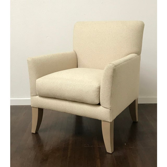 SHOWROOM SAMPLE Beautifully tailored lounge chair with hardwood maple legs. Loose cushion, foam wrapped in 25/75 down...
