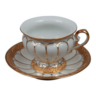 Meissen porcelain cup and saucer with golden pattern