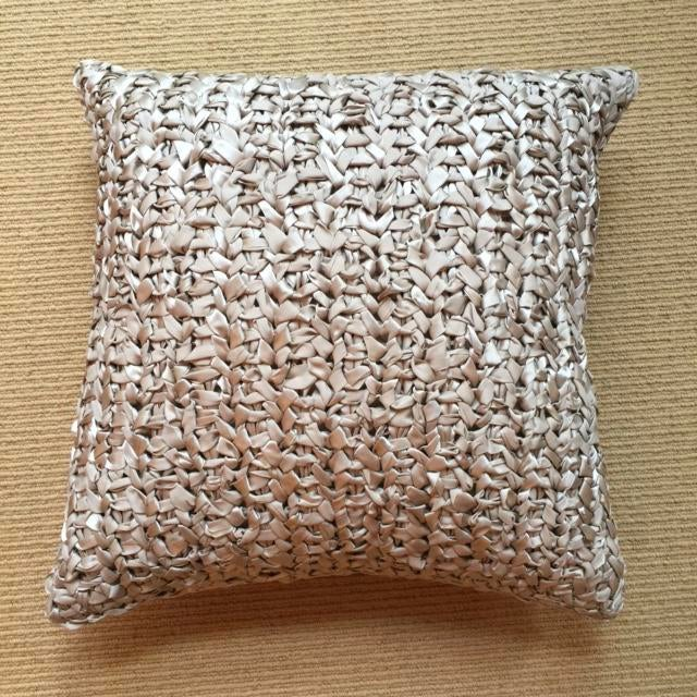 This woven silk ribbon pillow is square in shape with a contrasting back. Notable for its textural surface and comfortable...