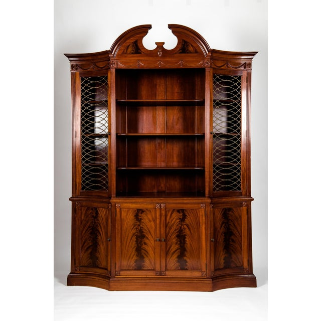 Handmade 20th century mahogany wood breakfront or cabinet with arch top and carved design details. Two parts, upper...