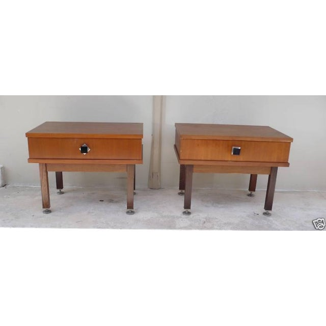 Pair of hot mid-century modern Danish Modern nightstands with teal bodies and rosewood legs measuring 20.5 inches long by...