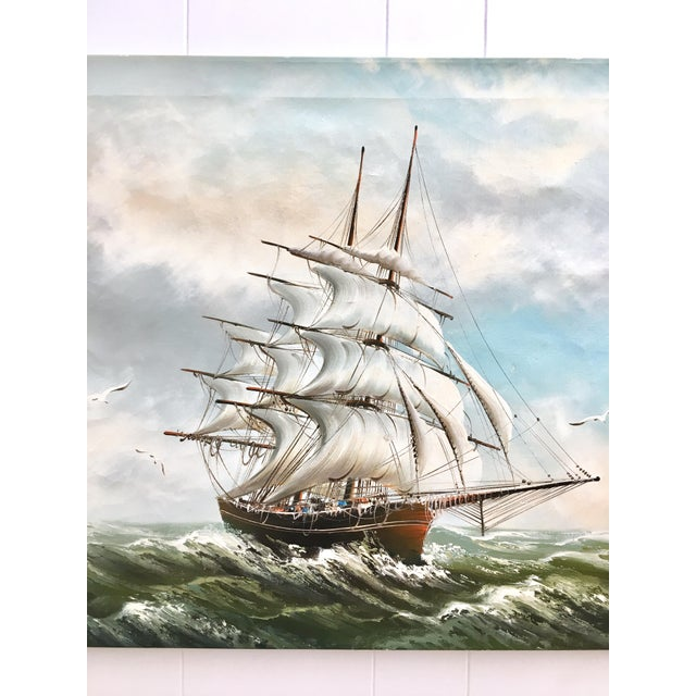 An original Nautical oil painting of a Colonial ship being tossed by the ocean waves signed by Rupert Hydan, known for his...