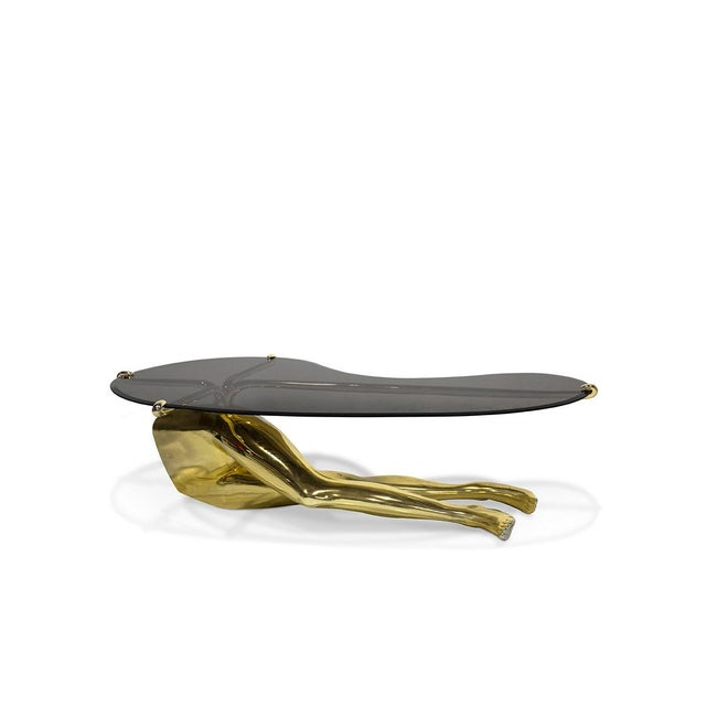 Add sex appeal and whimsy to your living room with the Tabu Cocktail Table. Sensual gold chromium legs stretch out beneath...