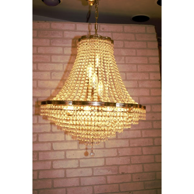 Swarovski crystal chandelier imported from the Czech Republic. Light function and the cord is in good condition.