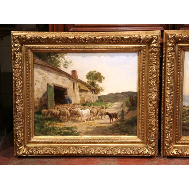 Beautiful pair of antique paintings in gilt frames from France, circa 1880. Each oil on canvas depicts a country scene...