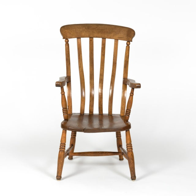 A rustic and charming English elm vertical slat back armchair circa 1890 with turned legs and H-stretcher. height: 39 in....