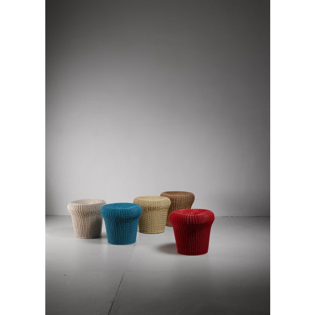 A set of five E14 rattan stools by Egon Eiermann. The stools were designed by Eiermann for his German pavilion at the...